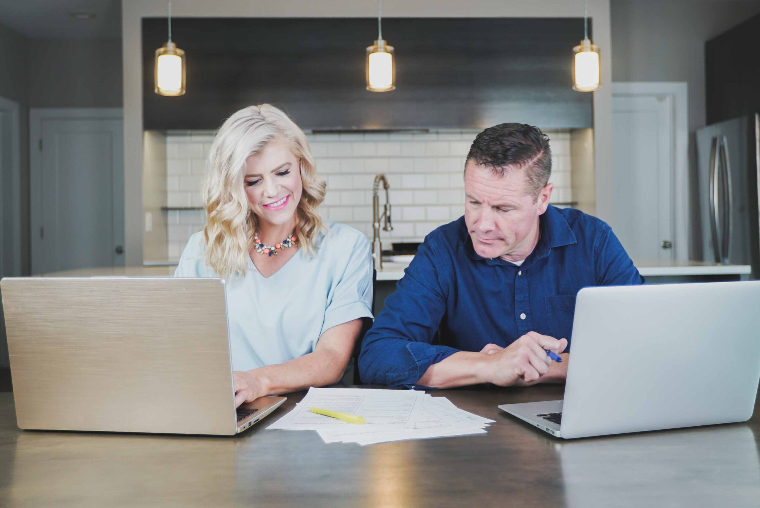 Divorced couple looking at documents