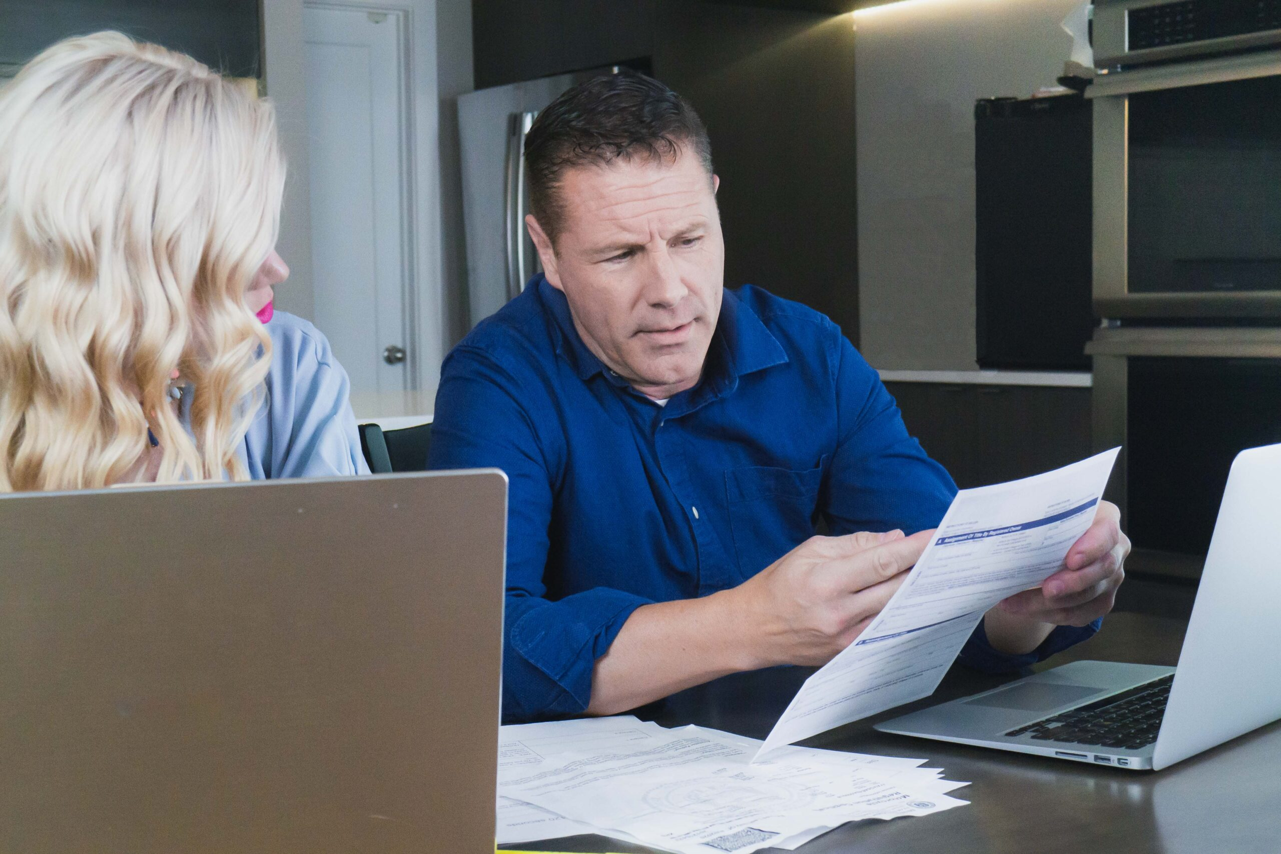 Divorcing couple looking over contracts