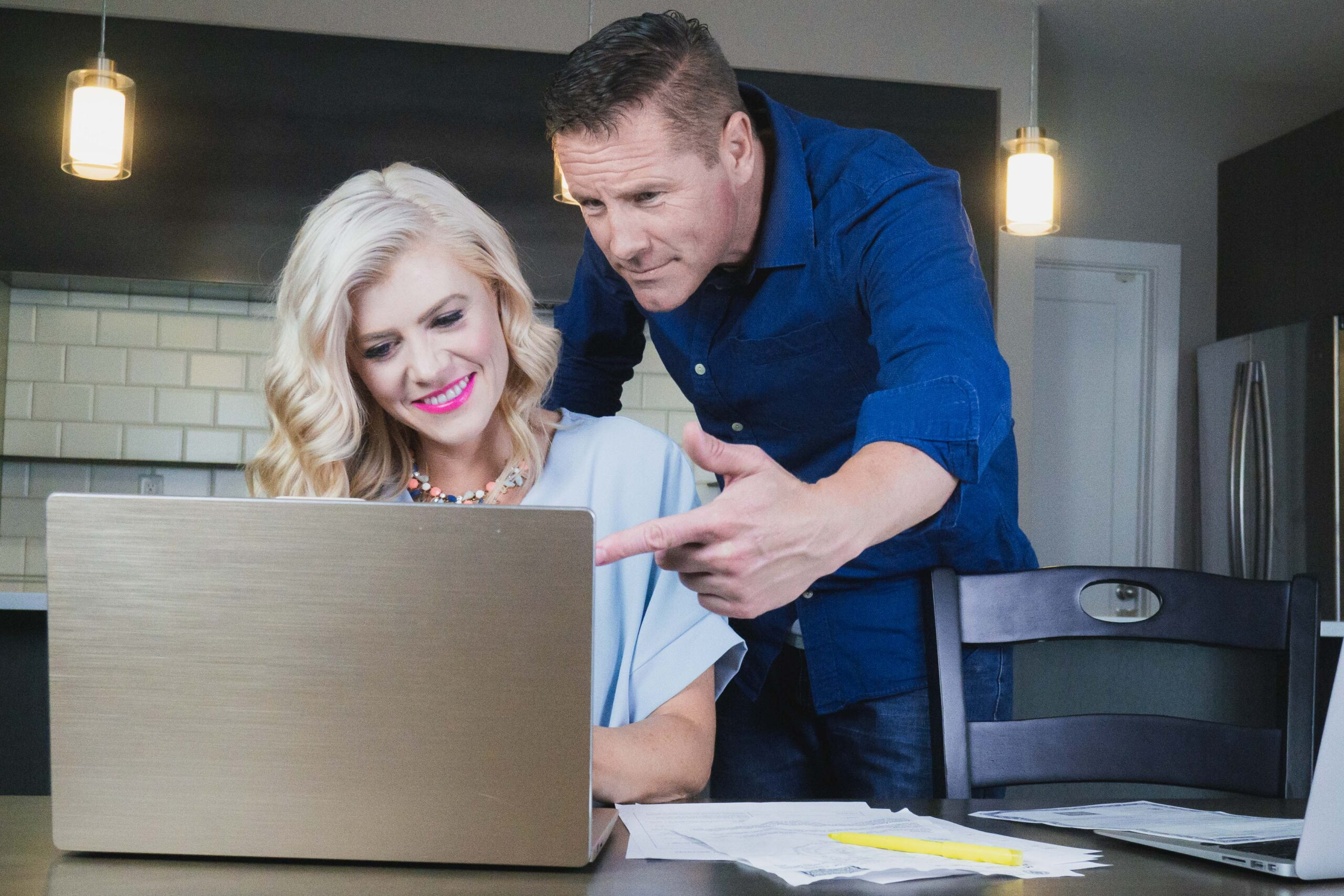 Divorcing couple working on computer